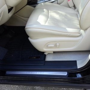 Graphite kickplates on wheat interior with black Weathertec Mats.