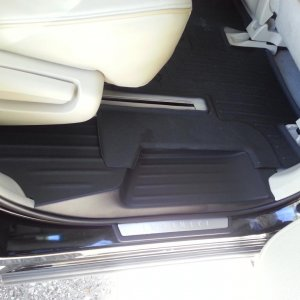 2nd row- Graphite kickplates on wheat interior with black Weathertec Mats.